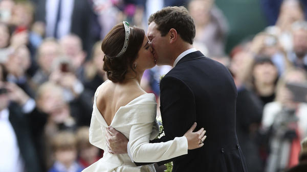 Princess Eugenie of York and Jack Brooksbank kiss after their wedding Friday in St. George's Chapel at Windsor Castle in England.