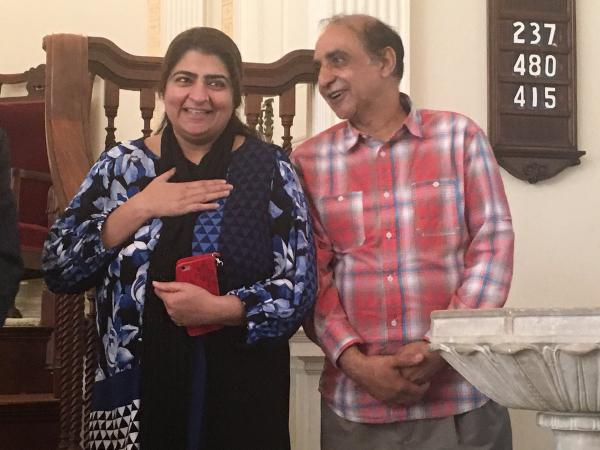 Zahida Altaf and Malik Naveed bin Rehman speak to supporters inside the First United Congressional Church of Old Lyme on Tuesday after learning that immigration officials have decided not to deport them, while the court considers their case.