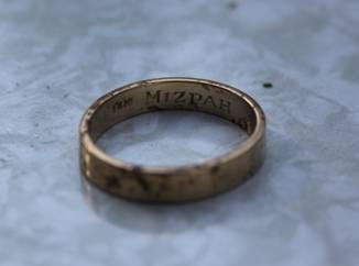 """The ring, photographed immediately after being discovered at Stalag Luft III. Part of the engraving reads, """"Mizpah,"""" meaning 'emotional bond' or 'watchtower' in Hebrew."""