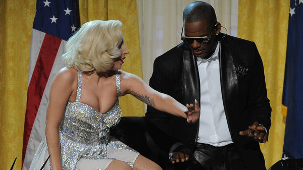 Lady Gaga and R. Kelly perform during the 2013 American Music Awards in Los Angeles.