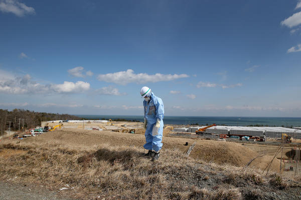 An employee of Tokyo Electric Power Co. works at Japan's Fukushima Dai-ichi nuclear power plant to decontaminate the area after the 2011 nuclear meltdown. A Vietnamese laborer in Japan on a training program says he was also put to work cleaning up the site, but with inadequate gear.