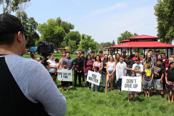Joe Hunt (left) films a group of students making a suicide prevention PSA in Milliken, Colorado.