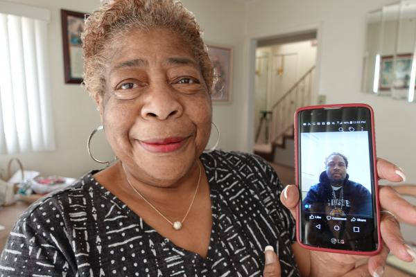 Charlotte Blackwell with a photo of her son, Air Force veteran Jermaine Petit. Petit was helped by a new program in Long Beach, Cal. that pairs law enforcement officers with VA counselors to help veterans in crisis.