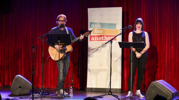 House musician Jonathan Coulton leads a music parody game, alongside Ophira Eisenberg, on <em>Ask Me Another</em> at the Bell House in Brooklyn, New York.