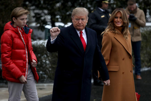 President Donald Trump (C) departs the White House with first lady Melania Trump (R) and their son, Barron (L), Feb. 1 in Washington, DC. Trump was traveling to his private club in Florida.