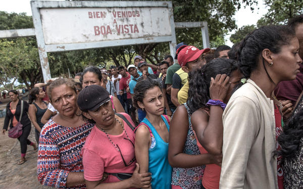 Venezuelans wait in line for food in northern Brazil in February 2018. The migrants often say the main reasons they've fled are to get food and health care.