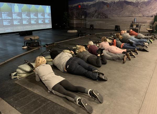 High school educators take part in a virtual firing range exercise as they tour Fort Carson, Col. Army leaders hope these tours will result in educators steering more students toward military service.