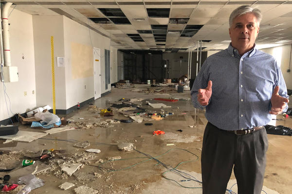 Tony Sholar of the Marine Corps stands in the abandoned headquarters of a Marine unit at Camp Lejeune, N.C. The building was damaged in Hurricane Florence, and rainwater still pours through damaged roof.