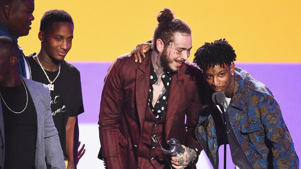 21 Savage, far right, and Post Malone on Aug. 20, 2018, during the 2018 MTV Video Music Awards at Radio City Music Hall.