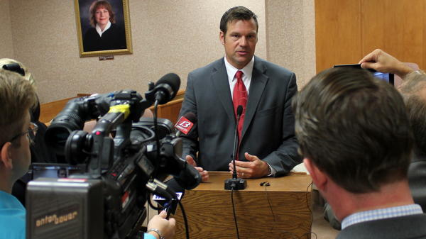 When he was Kansas' secretary of state, Kris Kobach drew the spotlight to his office.