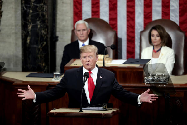 President Trump delivers his State of the Union address Tuesday to a joint session of Congress on Capitol Hill in Washington, as Vice President Pence and Speaker of the House Nancy Pelosi, D-Calif., watch.