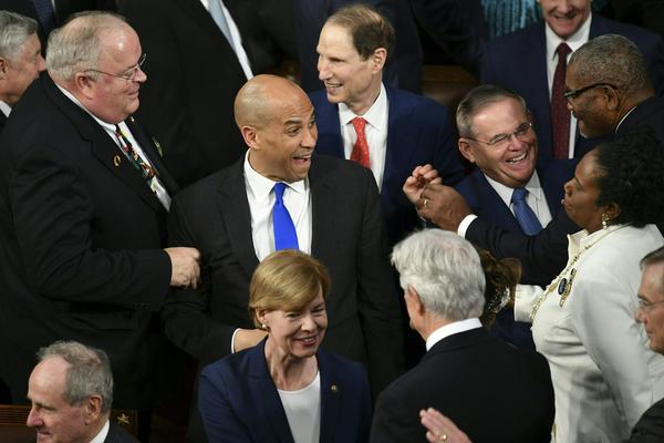 Senator from New Jersey Cory Booker greets other lawmakers ahead of the State of the Union address.