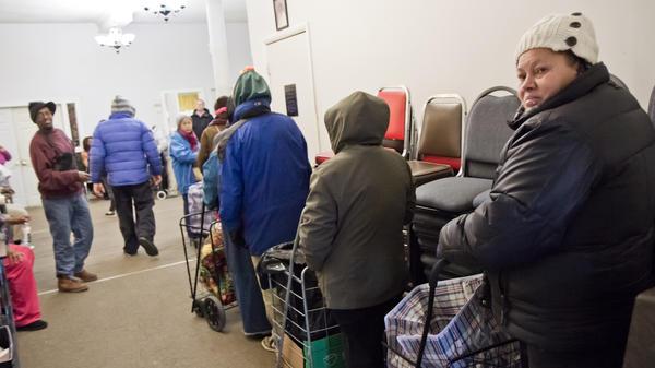 Residents of Reading, Pa., wait in line at the St. James Chapel food bank. Four out of 10 households in Reading receive Supplemental Nutrition Assistance Program benefits. During the shutdown, they received February benefits early, and many will run out before the next payment in March.