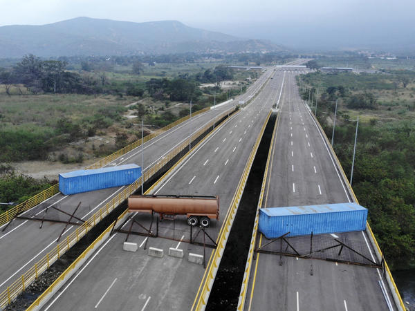 The Tienditas bridge connecting Colombia and Venezuela has been blocked by Venezuelan military forces, as seen here on Wednesday. Opposition leader Juan Guaidó and U.S. Secretary of State Mike Pompeo are demanding that humanitarian aid be allowed to enter.