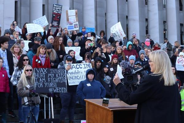 <p>Anti-vaccine advocates rally outside the Washington State Capitol in Olympia.</p>