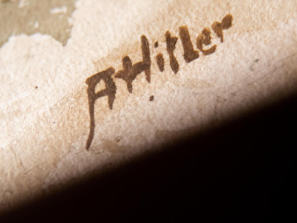 """A picture taken on Feb. 8, 2019 shows the signature """"AHitler"""" on a watercolor entitled <em>""""Im Wald""""</em> (In the forest) displayed at the Weidler auction house in the southern city of Nuremberg."""