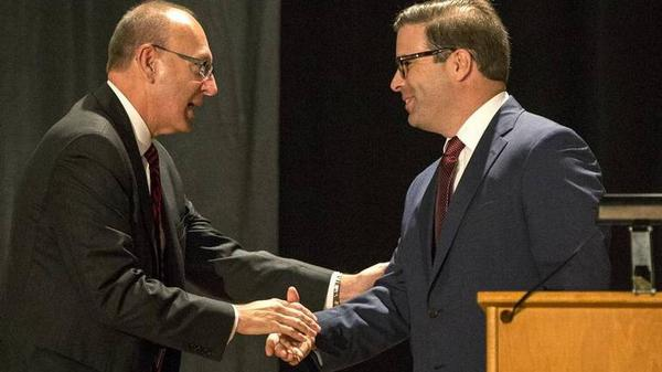 The Lindenwood University board of trustees voted Friday to fire university system president Michael Shonrock (left).In this 2015 photo, Shonrock is shaking hands with Brett Barger, who was the president of Lindenwood University-Belleville until Jan. 22.