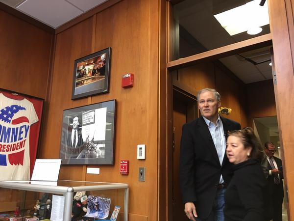 Gov. Jay Inslee enters a conference room at the New Hampshire Institute of Politics at Saint Anselm College where he spoke to students last month.