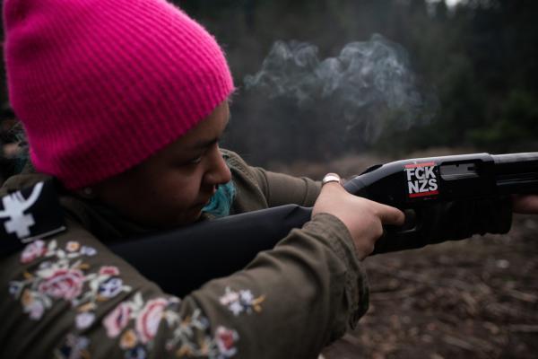 Rosie Strange, a leftist activist who chose to buy a handgun for self defense, fires a friend's shotgun on February 2, 2019, in Hood River, Oregon.