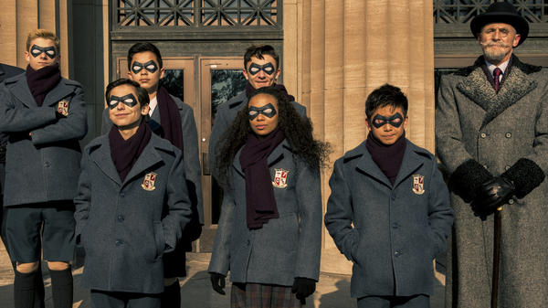Know that we still have each other: The members of <em>The Umbrella Academy </em>(l to r: Cameron Brodeur, Aidan Gallagher, Blake Talabis, Dante Albidone, Eden Cupid, Ethan Hwang, Colm Feore) say cheese.