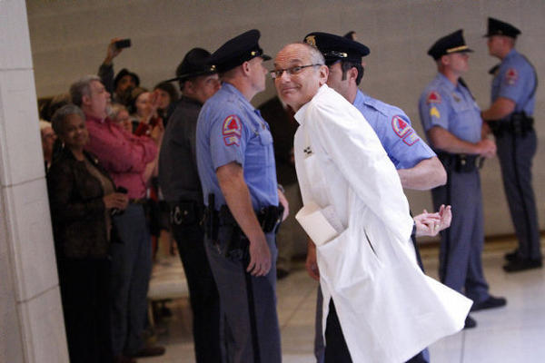 Photo of Dr. Charles Van Der Horst being arrested at a 2014 protest at the NCGA.