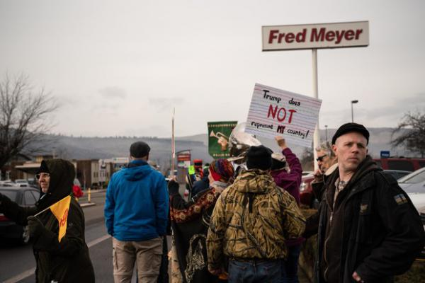 <p>Ross Eliot, a leftist activist and proponent for armed self-defense, looks behind the Women's March for any possible threats on Jan. 19, 2019 in The Dalles, Ore.</p>