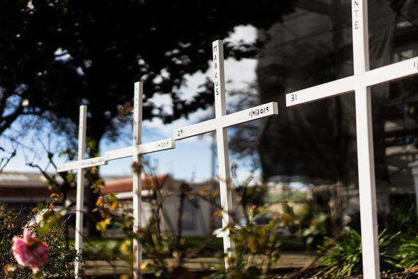 Memorial crosses for homicide victims are erected at St. Columba Catholic Church in Oakland, Calif. In East Oakland, where gun violence is chronic, some are grateful that America is paying more attention to it — but they would also like a focus on neighborhoods like theirs.