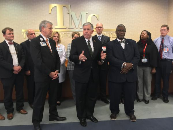 Speaking recently at Truman Medical Centers in Kansas City, Missouri Gov. Mike Parson, center, said he favored Medicaid reform rather than expansion. On his left is Truman CEO Charles Shields and on his right is Kansas City Mayor Sly James.