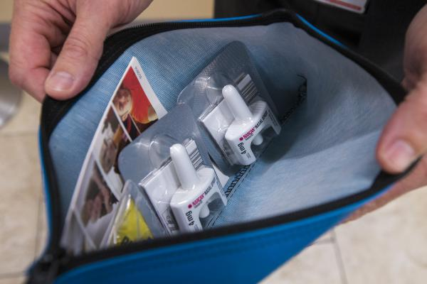 The contents of the naloxone kit inside an AED box located in the cafeteria of the West Roxbury VA (Jesse Costa/WBUR)