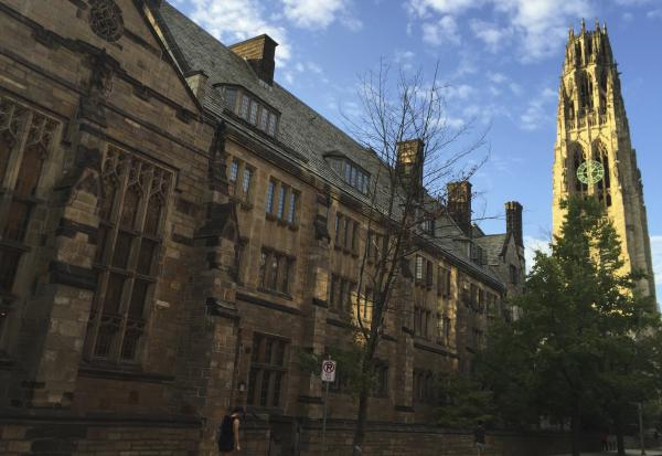 Harkness Tower on the campus of Yale University in New Haven. Three women who attend the university are suing the school and nine of its all-male fraternities, seeking to force the social organizations to admit women.