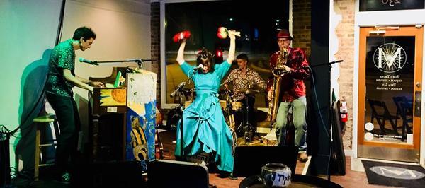 Tom Merrigan's Hot Raccoons display their onstage musical antics.