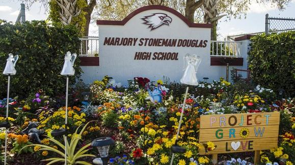 A memorial garden for the 17 people killed in the Feb. 14, 2018, mass shooting at Marjory Stoneman Douglas High School in Parkland, Fla.