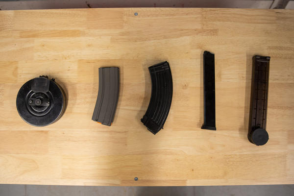 An assortment of high-capacity magazines at Delta Arsenal, from left to right: a 72-round drum, two 30-round magazines, a 10+ round magazine and a 50-round magazine.
