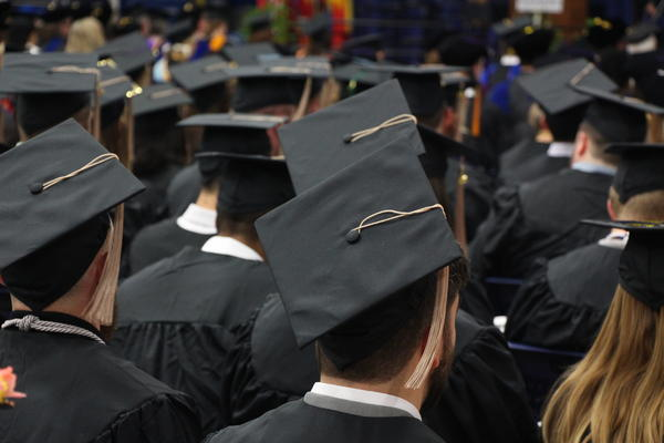 Students graduate from Washburn University in December 2018.