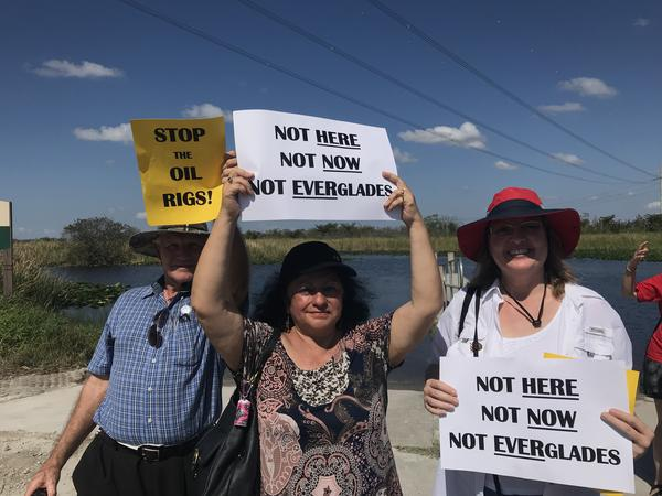 Environmentalist supporters held signs Tuesday in Everglades Holiday Park, to join with local lawmakers in opposing the Kanter Real Estate LLC oil drilling permit in the wetlands.