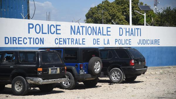 Five Americans and several other men were arrested after police discovered they were carrying a number of automatic rifles and pistols in Port-au-Prince. The men are being held at this Haitian National Police compound.