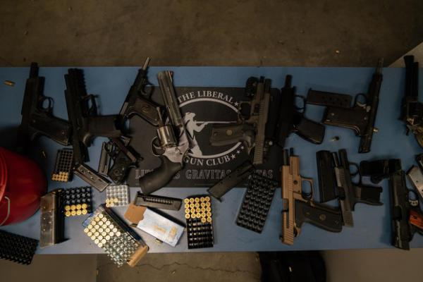 <p>Guns are splayed out at the gun range during The Liberal Gun Club's winter range day on Jan. 26, 2019 in Portland, Ore.</p>
