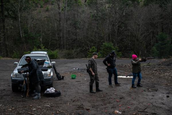 <p>Ross Eliot (center, left) and Rosie Strange (right) take target practice with other activists on Feb. 2, 2019 in Hood River, Ore.</p>