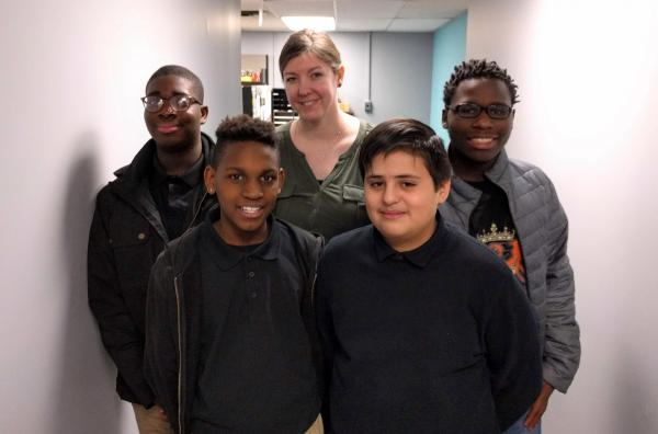 Coronado Middle School students (from left) Uhunoma Amayo, Daleshone Sharkey, Carlos Jimenez Reyes and DaQuon Cheadle designed an experiment to be conducted on the International Space Station. Erin Morley, center, helped guide them through the process.