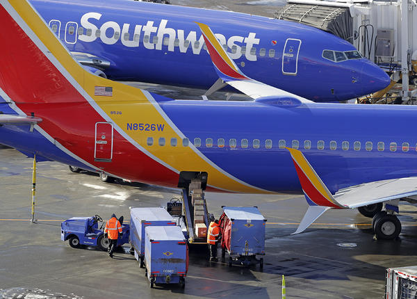 Southwest Airlines planes are loaded Tuesday, Feb. 5, 2019, at Seattle-Tacoma International Airport in Seattle.
