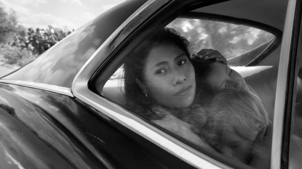 Yalitza Aparicio as Cleo, Marco Graf as Pepe, and Daniela Demesa as Sofi in <em>Roma</em>, written and directed by Alfonso Cuarón.