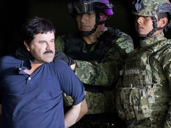 """Joaquín """"El Chapo"""" Guzmán was extradited to the U.S. in 2017 after two successful escapes from Mexican prisons. On Thursday, the Justice Department announced two of his sons have been indicted on a drug conspiracy charge. Both brothers are believed to be fugitives in Mexico."""