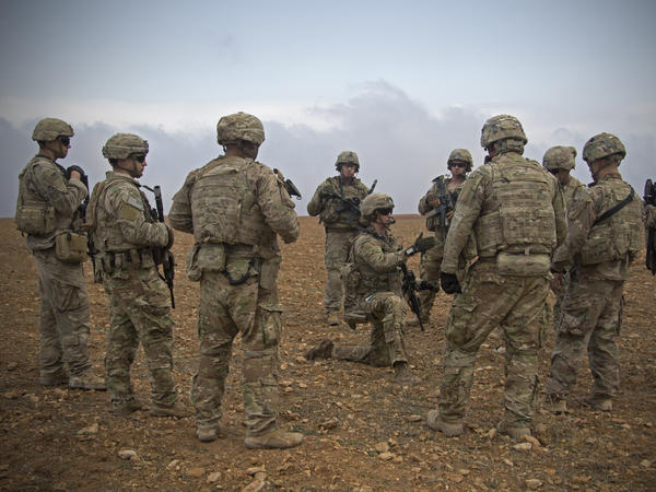 U.S. soldiers gather for a briefing during a combined joint patrol rehearsal in Manbij, Syria, in November 2018. The White House says about 400 troops will remain for an unspecified period of time.
