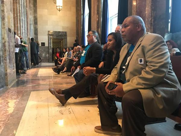 Checo Yancy (right) watches as the Louisiana Senate debates a bill in the 2018 legislative session that reinstates convicted felons' right to vote five years after release from prison.
