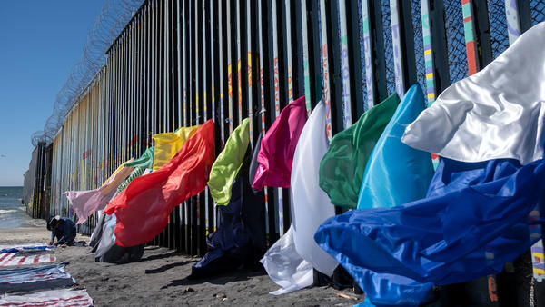 Central American migrant artist Robenz creates an installation on the Mexico-U.S. border fence in Playas de Tijuana, Baja California state, Mexico, on Feb. 24.
