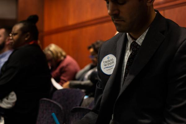 A supporter of the effort to build Connecticut's third casino in East Windsor wears a sticker bearing the project's name at a Public Safety and Security Committee hearing on February 26 in Hartford.