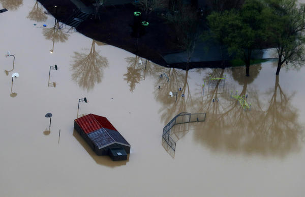 A playground sits underwater in a flooded neighborhood in Guerneville, Calif.