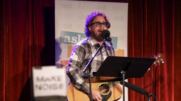 House musician Jonathan Coulton leads a parody game on Ask Me Another at the Bell House in Brooklyn, New York.