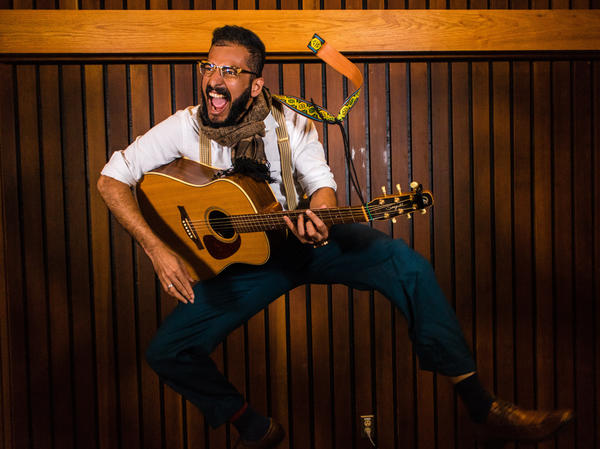 """Thanks in part to his original songwriting, singing and guitar-playing, Physics doctoral student Pramodh Senarath Yapa beat out the remaining entrants to win this year's """"Dance Your Ph.D."""" contest."""