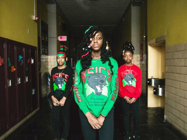 """Students at Betty Shabazz Academy in Chicago show off Desmond """"Des Money"""" Owusu's new school uniform designs."""